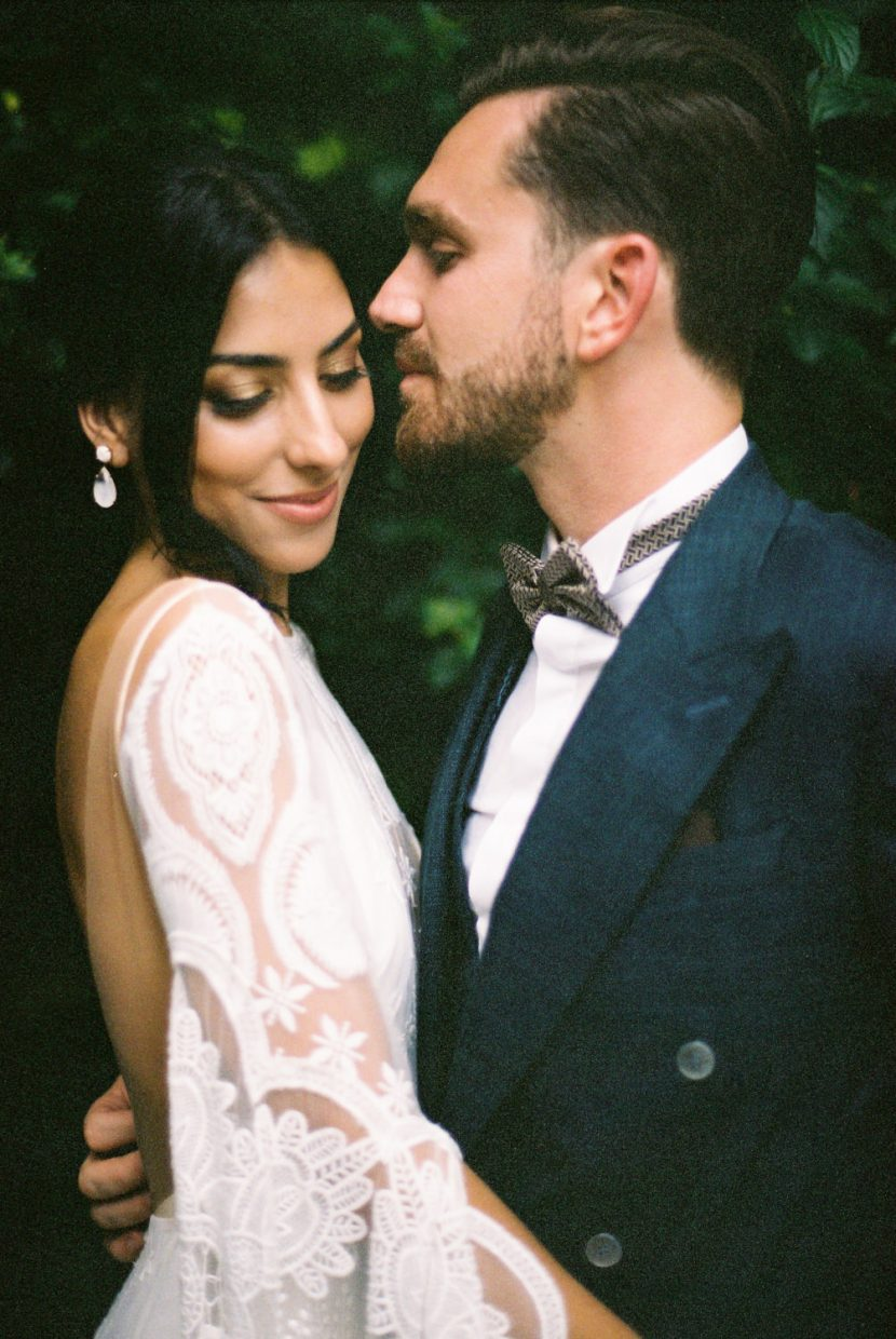Bride and groom sharing an intimate moment at their Portugal wedding