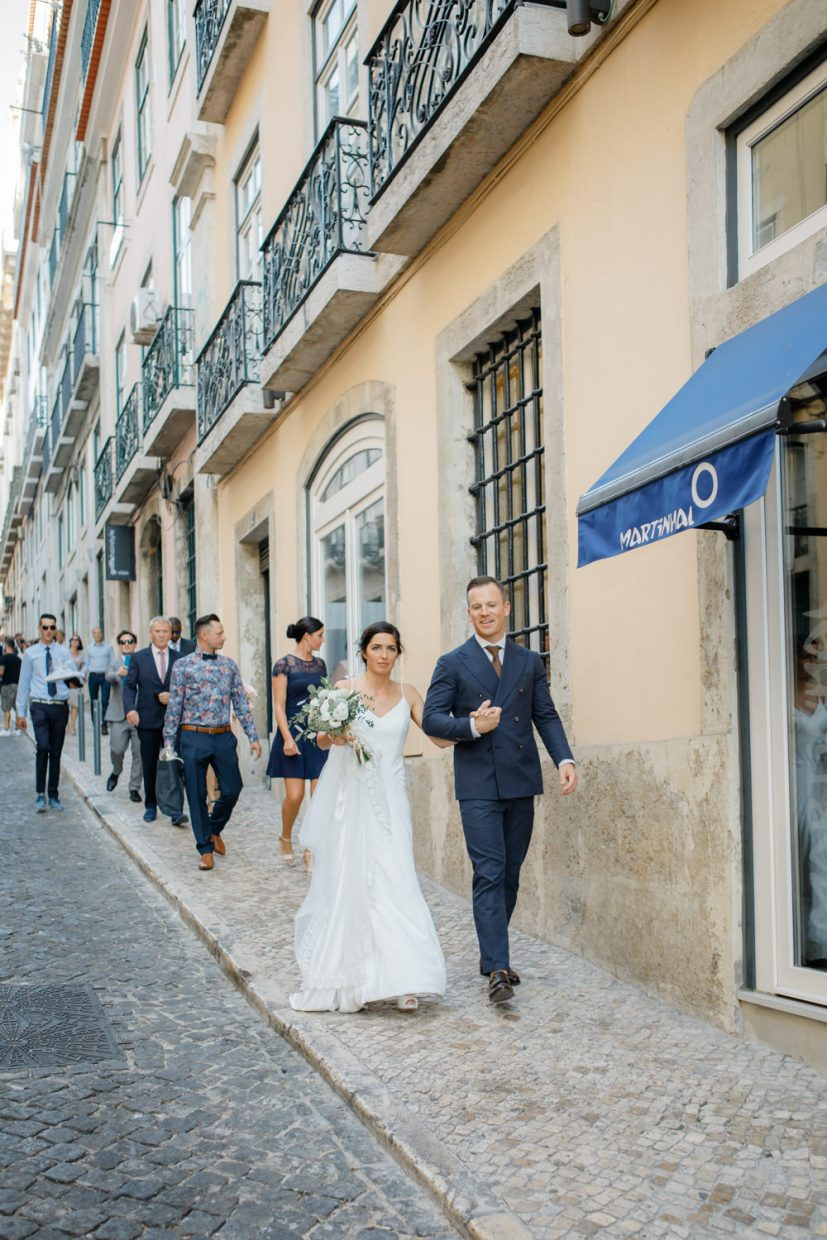 Bride and groom walking in the streets of Lisbon