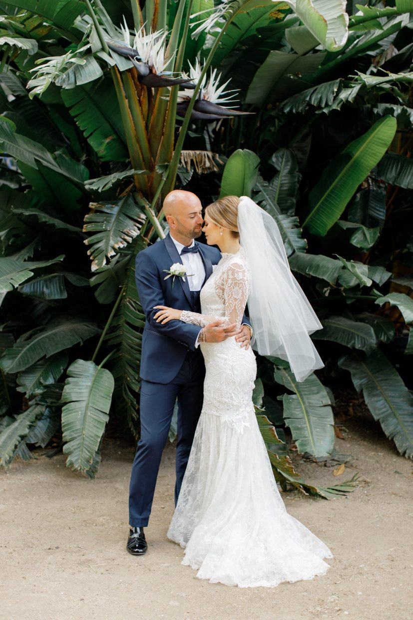 Stylish Bride and Groom in Yolan Cris Wedding Dress and Navy Suit at Palácio Fronteira wedding