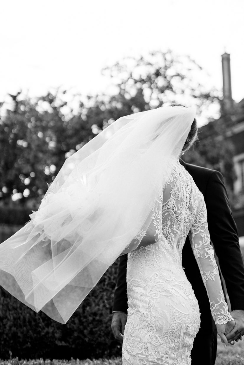 Veil in the wind while couple kiss at Palácio Fronteira Lisbon Wedding Venue